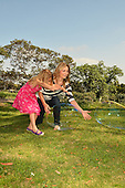 Stock photo of Mother and girl playing with  bubbles