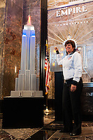 Former women's national team player April Heinrichs poses for a photo next to a model of the Empire State Building lit in the Red White and Blue colors of the US Soccer Federation during the centennial celebration of U. S. Soccer in New York, NY, on April 05, 2013.