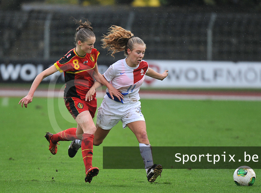 20131011 - SCHWEINFURT , GERMANY :  Dutch Suzanne Admiraal (11) pictured in a duel with Belgian Bieke Vandenbussche (8) during the female soccer match between Belgium Women U17 and The Netherlands U17 , in the first game of the Elite round in group6 in the UEFA European Women's Under 17 competition 2013 in the Willy Sachs Stadium - Schweinfurt. Friday 11 October 2013. PHOTO DAVID CATRY