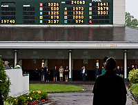 LOUISVILLE, KENTUCKY - MAY 04: Man watches the tote board during Thurby at Churchill Downs on May 4, 2017 in Louisville, Kentucky. (Photo by Scott Serio/Eclipse Sportswire/Getty Images)