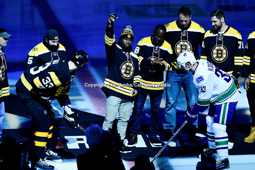 February 11, 2017: New England Patriots running back James White (28) drops a ceremonial puck before the National Hockey League game between the Vancouver Canucks and the Boston Bruins held at TD Garden, in Boston, Mass. Boston defeats Vancouver 4-3 in regulation time. Eric Canha/CSM