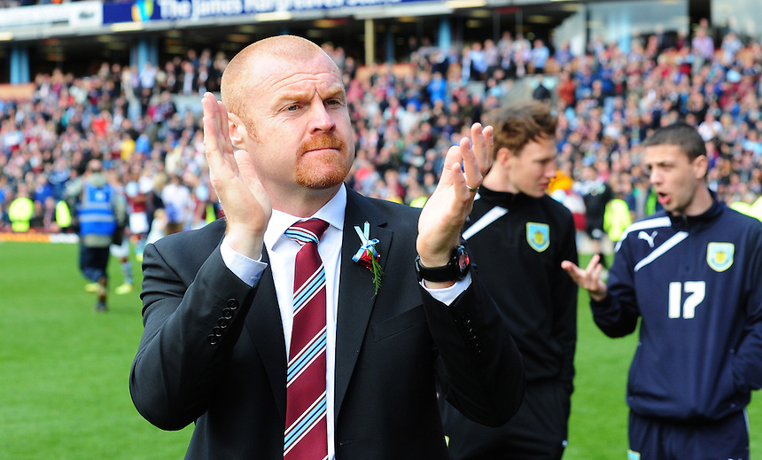 Burnley's Manager Sean Dyche applauds the fans at the final whistle<br /> <br /> Photo by Chris Vaughan/CameraSport<br /> <br /> Football - The Football League Sky Bet Championship - Burnley v Ipswich Town - Saturday 26th April 2014 - Turf Moor - Burnley<br /> <br /> &copy; CameraSport - 43 Linden Ave. Countesthorpe. Leicester. England. LE8 5PG - Tel: +44 (0) 116 277 4147 - admin@camerasport.com - www.camerasport.com