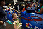 Spectators watch a segment of a taped speech from Pres. Barack Obama on a television during a taping of a live MSNBC show at the EpiCentre the day before the opening of the 2012 Democratic National Convention on Monday, September 3, 2012 in Charlotte, NC.