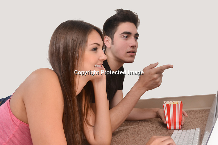 Stock photo of couple on computer