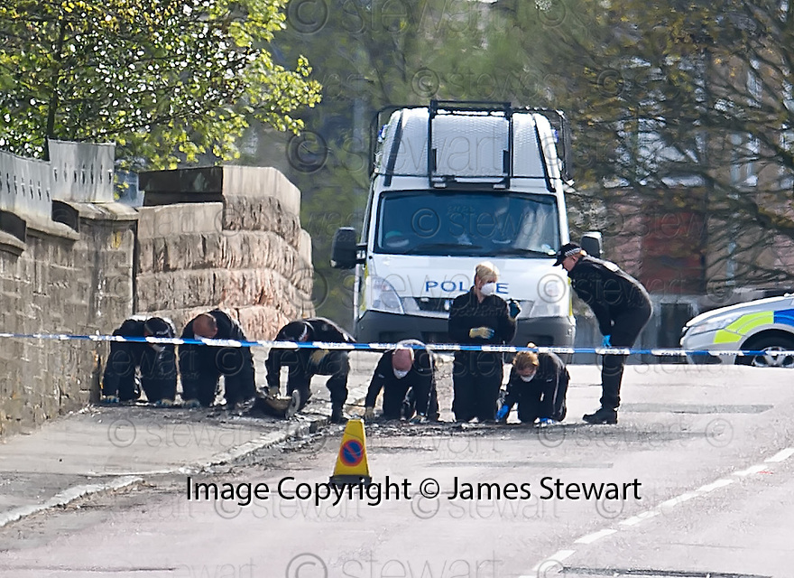 Police search Bonkle Road in Newmains where a burnt out vehicle, suspected in being involved in the incident which led to the death of Frank Baxter, was found ......