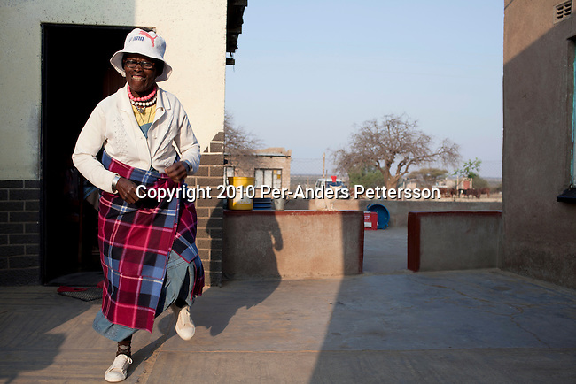 GA-MASEHLONG, SOUTH AFRICA - AUGUST 7: Mmina Sekgala, age 80, runs like her grandchild Caster Semenya outside her house on August 7,  in GA-MASEHLONG, South Africa. Caster Semenya won the 800 meters world championship gold medal in Berlin in 2009 was recently cleared to run after her career was held back due to gender testing. She grew up in this rural village in Limpopo, northern South Africa, and she started running only a few years ago, and quickly appeared from nowhere to the world stage. After being banned for almost a year she was cleared by the IAAF and cleared to compete in July 2010. (Photo by Per-Anders Pettersson/Getty Images)