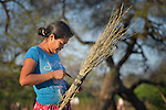 Elsa Juarez, a Wichi indigenous woman in Santa Victoria Este, Argentina, tightens the strap on her broom as she sweeps the ground around her home. The Wichi in this area have struggled for decades to recover land that has been systematically stolen from them by cattleraisers and large agricultural plantations. After years of negotiation supported by Church World Service, a landmark 2014 agreement will divide the land in this region between indigenous communities and settlers, guaranteeing the survival of the Wichi.
