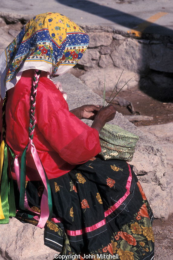 Tarahumara Indian woman weaving a pine needle basket at the Divisidero lookout, Copper Canyon, Chihuahua, Mexico