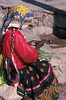Tarahumara Indian woman weaving a pine needle basket at the Divisidero lookout, Copper Canyon, Chihuahua, Mexico