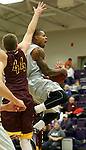SIOUX FALLS, SD - JANUARY 30:  Charles Ward #22 from the University of Sioux Falls takes the ball to the basket past Brett Ervin #44 from Minnesota Duluth in the first half of their game Friday night at the Stewart Center.  (Photo by Dave Eggen/Inertia)