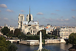 Aerial view of Notre Dame Notre-Dame cathedral from Left Bank with Ile de la Cite and highrise office towers of La Defense in backgroundcity of Paris. Paris. France