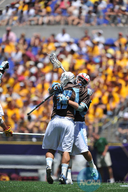 30 MAY 2010: Ryan Molloy (17) of Tufts University celebrates a goal with Doug DiSesa (5) against Salisbury University during the Division III Men's Lacrosse Championship held at M+T Bank Stadium in Baltimore, MD. Tufts defeated Salisbury 9-6 for the national title. Larry French/NCAA Photos