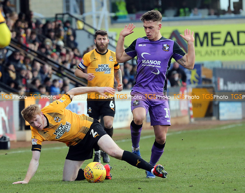 Luke Hannant of Port Vale and Brad Halliday of Cambridge United during Cambridge United vs Port Vale, Sky Bet EFL League 2 Football at the Cambs Glass Stadium on 9th February 2019