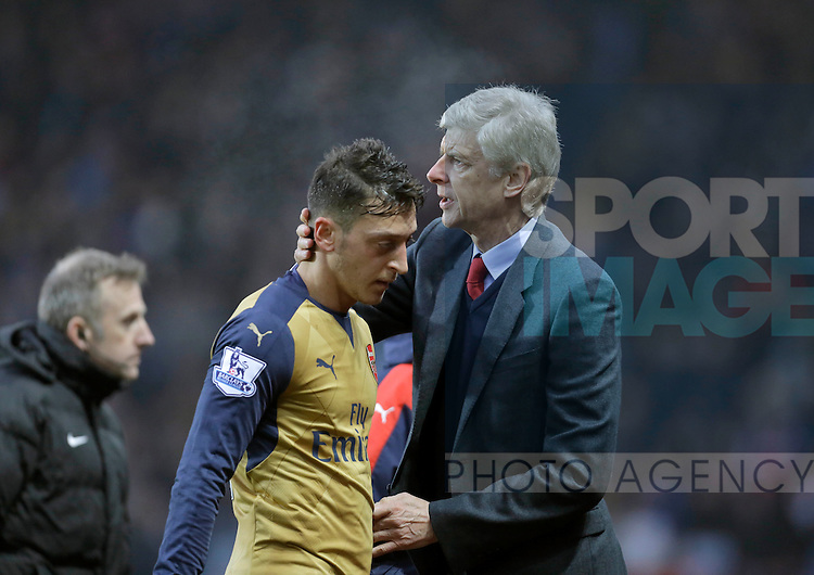 Arsenal manager Arsene Wenger consoles Mesut Ozil following his substitution - Football - Barclays Premier League - Aston Villa vs Arsenal - Villa Park Birmingham - 13th December 2015 - Season 2015/2016 - Photo Malcolm Couzens/Sportimage