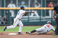 Michigan Wolverines second baseman Ako Thomas (4) turns a double play during Game 11 of the NCAA College World Series against the Texas Tech Red Raiders on June 21, 2019 at TD Ameritrade Park in Omaha, Nebraska. Michigan defeated Texas Tech 15-3 and is headed to the CWS Finals. (Andrew Woolley/Four Seam Images)