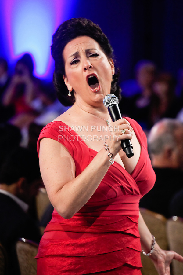 Soprano singer Cristina Fontanelli performs before the Nedtret Taciroglu fashion show, during Couture Fashion Week, in the Waldorf-Astoria Grand Ballroom September 16th 2011.
