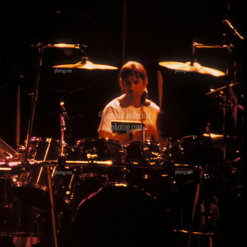 Crop of Mickey Hart. The Grateful Dead performing Desolation Row at the Knickerbocker Arena Albany NY, 24th of March 1990. View from the Lighting Booth, Dead Center, Floor.