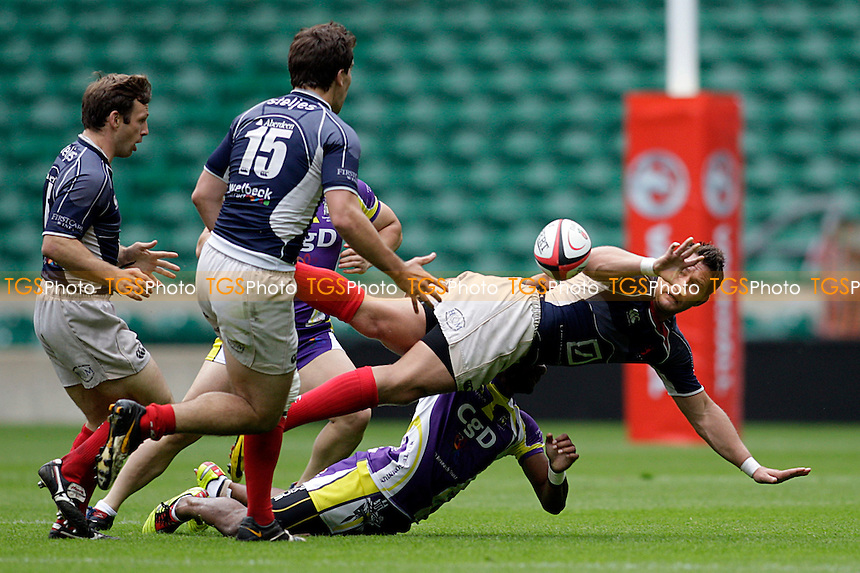 Oli Brown of London Scottish offloads - Middlesex Charity Sevens Rugby at Twickenham Stadium - 09/07/11 - MANDATORY CREDIT: Helen Watson/TGSPHOTO - Self billing applies where appropriate - 0845 094 6026 - contact@tgsphoto.co.uk - NO UNPAID USE
