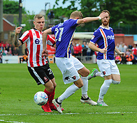 Lincoln City's Harry Anderson vies for possession with Exeter City's Dean Moxey<br /> <br /> Photographer Andrew Vaughan/CameraSport<br /> <br /> The EFL Sky Bet League Two Play Off First Leg - Lincoln City v Exeter City - Saturday 12th May 2018 - Sincil Bank - Lincoln<br /> <br /> World Copyright &copy; 2018 CameraSport. All rights reserved. 43 Linden Ave. Countesthorpe. Leicester. England. LE8 5PG - Tel: +44 (0) 116 277 4147 - admin@camerasport.com - www.camerasport.com