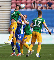 Preston North End's Joe Rafferty clears the danger away from Wigan Athletic's Nick Powell<br /> <br /> Photographer David Shipman/CameraSport<br /> <br /> The EFL Sky Bet Championship - Wigan Athletic v Preston North End - Monday 22nd April 2019 - DW Stadium - Wigan<br /> <br /> World Copyright © 2019 CameraSport. All rights reserved. 43 Linden Ave. Countesthorpe. Leicester. England. LE8 5PG - Tel: +44 (0) 116 277 4147 - admin@camerasport.com - www.camerasport.com