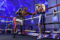 Nathanael Wilson (L) defeats Dylan Draper during a Boxing Show at The Devere Grand Connaught Rooms on 9th May 2019