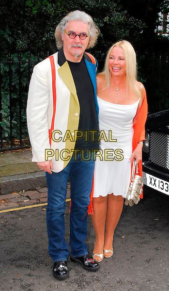 BILLY CONNOLLY & PAMELA STEPHENSON.Sir David Frost Summer Party, Carlyle Square, London, UK..July 5th, 2006.Ref: CAN.full length silver purse bag shoes red orange pashmina jeans denim jacket white dress husband wife married.www.capitalpictures.com.sales@capitalpictures.com.©Capital Pictures
