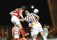 Michael Devlin heads away while holding Sam Parkin in the St Mirren v Hamilton Academical Scottish Communities League Cup match played at St Mirren Park, Paisley on 25.9.12.