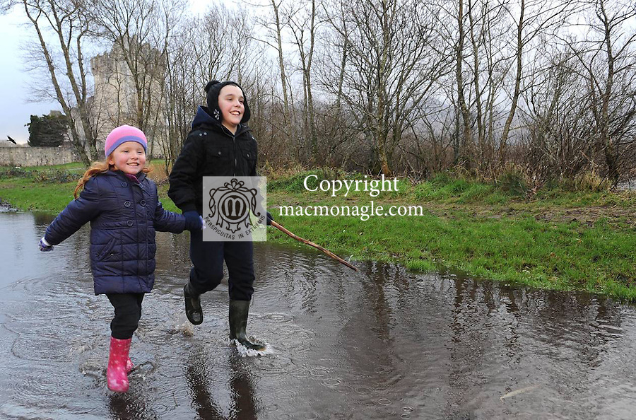 03-01-12: Lauren (4) and Christopher Carey (10), Killarney,  running through a flooded roadway  near  Ross Castle, Killarney on Tuesday.  Picture: Eamonn Keogh (MacMonagle, Killarney)