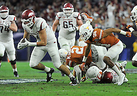 NWA Media/Michael Woods --12/29/2014-- w @NWAMICHAELW...University of Arkansas tight end Hunter Henry runs the ball after recovering a fumble by teammate Jared Cornelius  in the 1st quarter of the Texas Bowl Monday night at  NRG Stadium in Houston.