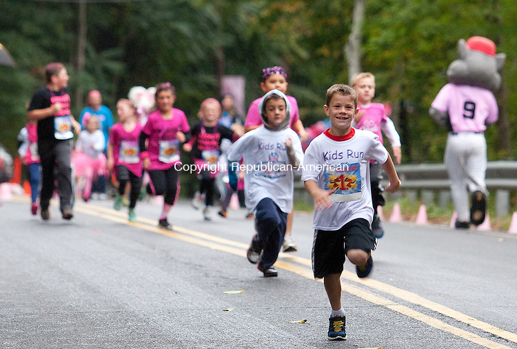 SEYMOUR, CT.- 04 OCTOBER 2014 - 100414JW01. - Kooper Harmeling age 8 leads the pack during the Kid's Run of Seymour Pink's 3rd Annual 5K Saturday morning.<br /> Jonathan Wilcox Republican-American