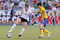 Heather O'Reilly, Therese Sjogran..USWNT tied Sweden 1-1 at Morrison Stadium, Omaha Nebraska.