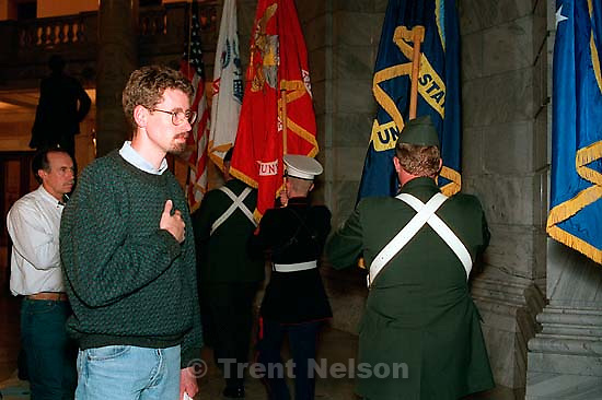 Tribune reporter Tom Zoellner holds his hand over his heart as the Utah Joint Service Color Guard &amp; 419th Transportation Unit passes at the Utah Veterans of Desert Storm &amp; America's Foreign Wars Candlelight Ceremony<br />