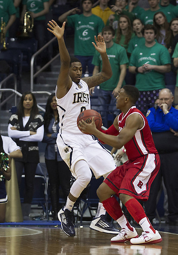 January 19, 2013:  Rutgers guard Eli Carter (5) goes up fro a shot as Notre Dame guard Eric Atkins (0) defends during NCAA Basketball game action between the Notre Dame Fighting Irish and the Rutgers Scarlett Knights at Purcell Pavilion at the Joyce Center in South Bend, Indiana.  Notre Dame defeated Rutgers 69-66.
