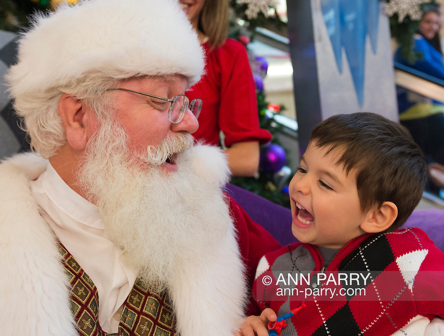"""Nov. 21, 2012 - Garden City, New York, U.S - Santa Claus gets a Christmas holiday visit from PATRICK HERR, 3 1/2, from Hempstead, at Roosevelt Field shopping mall in Long Island. Patrick's parents Juliana and Ismael took him to visit the jolly man who says """"Ho, ho, ho!"""" Roosevelt Field, one of the 10 largest shopping malls in the United States of America, is on the site where aviator Charles Lindbergh began his historic solo transatlantic flight to Paris in 1927."""