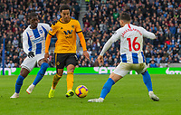 Wolverhampton Wanderers' Helder Costa (centre) under pressure from  Brighton &amp; Hove Albion's Yves Bissouma (left) &amp; Alireza Jahanbakhsh (right) <br /> <br /> Photographer David Horton/CameraSport<br /> <br /> The Premier League - Brighton and Hove Albion v Wolverhampton Wanderers - Saturday 27th October 2018 - The Amex Stadium - Brighton<br /> <br /> World Copyright &copy; 2018 CameraSport. All rights reserved. 43 Linden Ave. Countesthorpe. Leicester. England. LE8 5PG - Tel: +44 (0) 116 277 4147 - admin@camerasport.com - www.camerasport.com