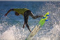 Craig Warton (AUS)..Cottesloe Beach, Perth, Western Australia, Saturday August 18 2001..A round of  The Quiksilver Airshow International Series, with $20,000 in prize-money was run today at Cottesloe Beach. The Quiksilver Airshow is the richest and most spectacular surfing event to be staged at a Perth Beach. The contest is based around the futuristic moves of aerial surfing, where each surfer  is judged on their best two aerial manoeuvres in each heat. (Photo: joliphotos.com)