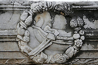 CORINTH, GREECE - APRIL 16 : A detail of Roman sculpture, on 16 April 2007 in Corinth, Greece. This wall relief shows a man rowing a boat surrounded by a garland of fruit and leaves. Corinth, founded in Neolithic times, was a major Ancient Greek city, until it was razed by the Romans in 146 BC. Rebuilt a century later it was destroyed by an earthquake in Byzantine times. (Photo by Manuel Cohen)