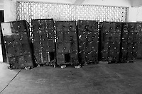 Old rusting lockers in disrepair are seen in a corridor at the Rajan Babu TB hospital in New Delhi, India.