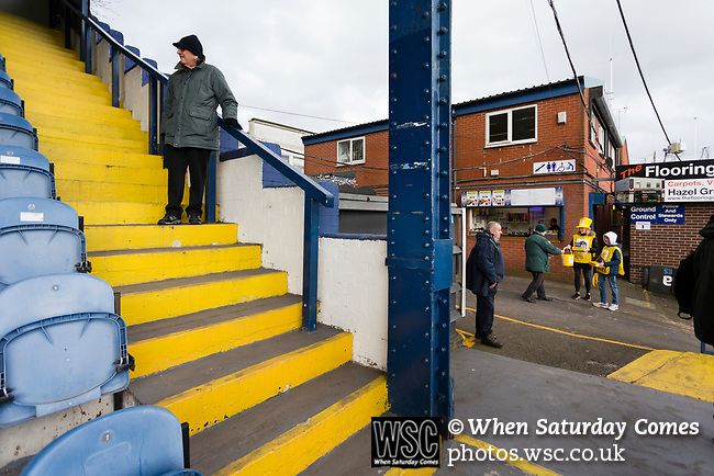 Early arrivals at the corner of The Danny Bergara Stand and the closed away end. Stockport County v Barnet, 07032020. Edgeley Park, National League. Photo by Paul Thompson.
