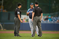 Trenton Thunder manager Jay Bell (11) talks with umpires Mike Savakinas and Thomas Roche during a game against the New Hampshire Fisher Cats on August 19, 2018 at ARM & HAMMER Park in Trenton, New Jersey.  New Hampshire defeated Trenton 12-1.  (Mike Janes/Four Seam Images)