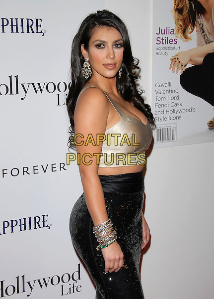 KIM KARDASHIAN .attends The 4th Annual Hollywood Style Awards held at Th ePacific Design Center in Beverly Hills, California, USA, October 07 2007.   .half length gold top cropped black sequined high waisted pencil skirt rear back behind over shoulder.CAP/DVS.©Debbie VanStory/Capital Pictures