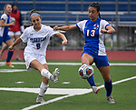 Freeeburg midfielder Peyton Ganz (8, left) kicks the ball past Roxana defender Brynn Huddleston in the first half. Roxana High School played a girls soccer game at Freeburg High School on Thursday May 3, 2018. Tim Vizer | Special to STLhighschoolsports.com