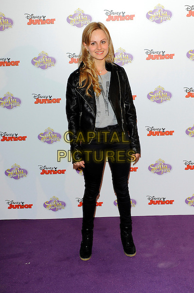 Tina O'Brien.The launch of the Disney TV Series 'Sofia The First' at the Mayfair Hotel, London, England..22nd February 2013.full length black leather jacket grey gray top jeans denim boots.CAP/CJ.©Chris Joseph/Capital Pictures.