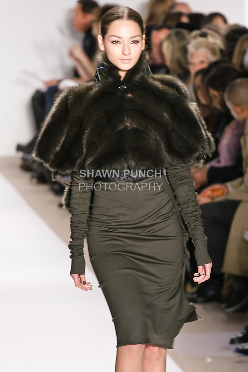 Bruna Tenorio walks the runway in an evergreen russian sable and alligator capelet with net, and evergreen wool knit skirt and top,  by Dennis Basso for his Dennis Basso Fall Winter 2010 collection fashion show, during Mercedes-Benz Fashion Week Fall 2010.
