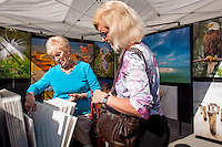 Janet Aiello and Norma Flowers check out Dennis Goodman's work during Naples Art Association's annual Art in the Park at The von Liebig Art Center, Naples, Florida, USA, Dec. 1, 2012. Photo by Debi Pittman Wilkey