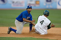 Columbus Catfish shortstop Omar Luna (7) puts the tag on Juan Lagares (4) of the Savannah Sand Gnats at Grayson Stadium in Savannah, GA, Wednesday August 6, 2008  (Photo by Brian Westerholt / Four Seam Images)