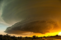 A spectacular sight in the setting sun as this highly striated supercell thunderstorm is illuminated a golden orange over Morris county Kansas on June 19th, 2011. This storm resulted in hail to the size of baseballs and a small tornado over open range-land.