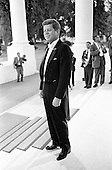 United States President John F. Kennedy stands on the North Portico of the White House in Washington, DC awaiting the arrival of President of the Ivory Coast, Félix Houphouët-Boigny, and First Lady of the Ivory Coast, Marie-Thérèse Houphouët-Boigny prior to a State Dinner in their honor on May 22, 1962. <br /> Credit: Arnie Sachs / CNP