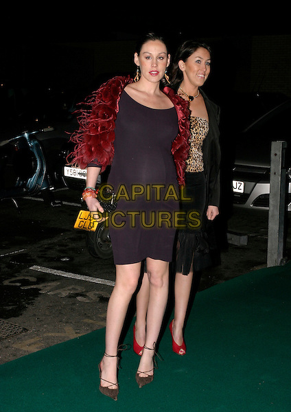 LUCY RUDESKI.Why Not? Charity Event, Westbourne Studios, London, UK..November 24th, 2005.Ref: AH.full length back dress pregnant feathers.www.capitalpictures.com.sales@capitalpictures.com.© Capital Pictures.