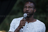 """Soumaila Diawara (Poet & Activist).<br /> <br /> Rome, 05/07/2020. Today, thousands of people gathered in Piazza San Giovanni to attend the """"Stati Popolari"""". The rally, organised by Aboubakar Soumahoro (1.) - Trade Union Coordinator of the Unione Sindacale di Base USB, was meant to be a popular answer by the """"Invisibles"""" to the """"Stati Generali dell'Economia"""" (States General of the Economy, 2.) of the Italian Prime Minister Giuseppe Conte, a 10-day-long meeting held in June at Villa Doria Pamphili (Villa Doria Pamphilj, 2.) where Italian and EU leaders / members of Governments, bankers, investors, advisors, met to discuss the economic recovery from the Covid-19 / Coronavirus crisis. From the organisers Facebook event page: «The Popular States will be our agora, where different realities will bring their pains and their proposals. A human square to make all the invisible visible and to give voice to all the unheard, our only symbol. The Popular States will be the communion of our needs and our struggles […]» (3.). At the end of the demo Soumahoro, who mainly deals with protection of """"Braccianti"""" (agricultural workers) rights, fights against """"caporalato"""" (illegal hiring) and the exploitation along the agricultural supply chain, gave a speech (4.) addressing the requests to the Government: - National plan for the work emergency; - Public housing program; - integral reform of the food supply chain; - radical transformation of migration policies (including, the """"right to return"""" for Italian migrants); - abolish the """"Security decrees"""" and cancel Bossi-Fini law; - reform the reception; - ecological transition strategy; - proactive interventions against discrimination and for equality.<br /> <br /> Footnotes & Links:<br /> 1. (Wikipedia.org) http://bit.do/fF4rH<br /> 2. 16.06.20 Aboubakar Soumahoro: Hunger/Thirst Strike And Meeting With Italian Prime Minister Conte http://bit.do/fGrbH<br /> 3. http://bit.do/fGrbD & https://www.facebook.com/StatiPopolari/<br /> 4. Aboubakar S"""
